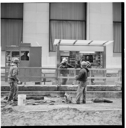 Men working on Wall Street