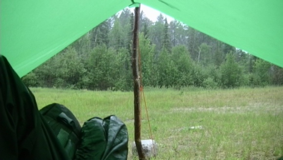 June 20- The view out of my tarp as I waited out a storm outside of the town of Ignace, Ontario. It was a deluge of rain but the tarp kept me dry. The folowing morning a black bear woke me up, sniffing around the outside of the tarp. Alas, I have found myself on an adventure!
