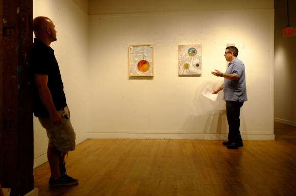 Gabe, on the left, having his work critiqued by our painting professor Jason.